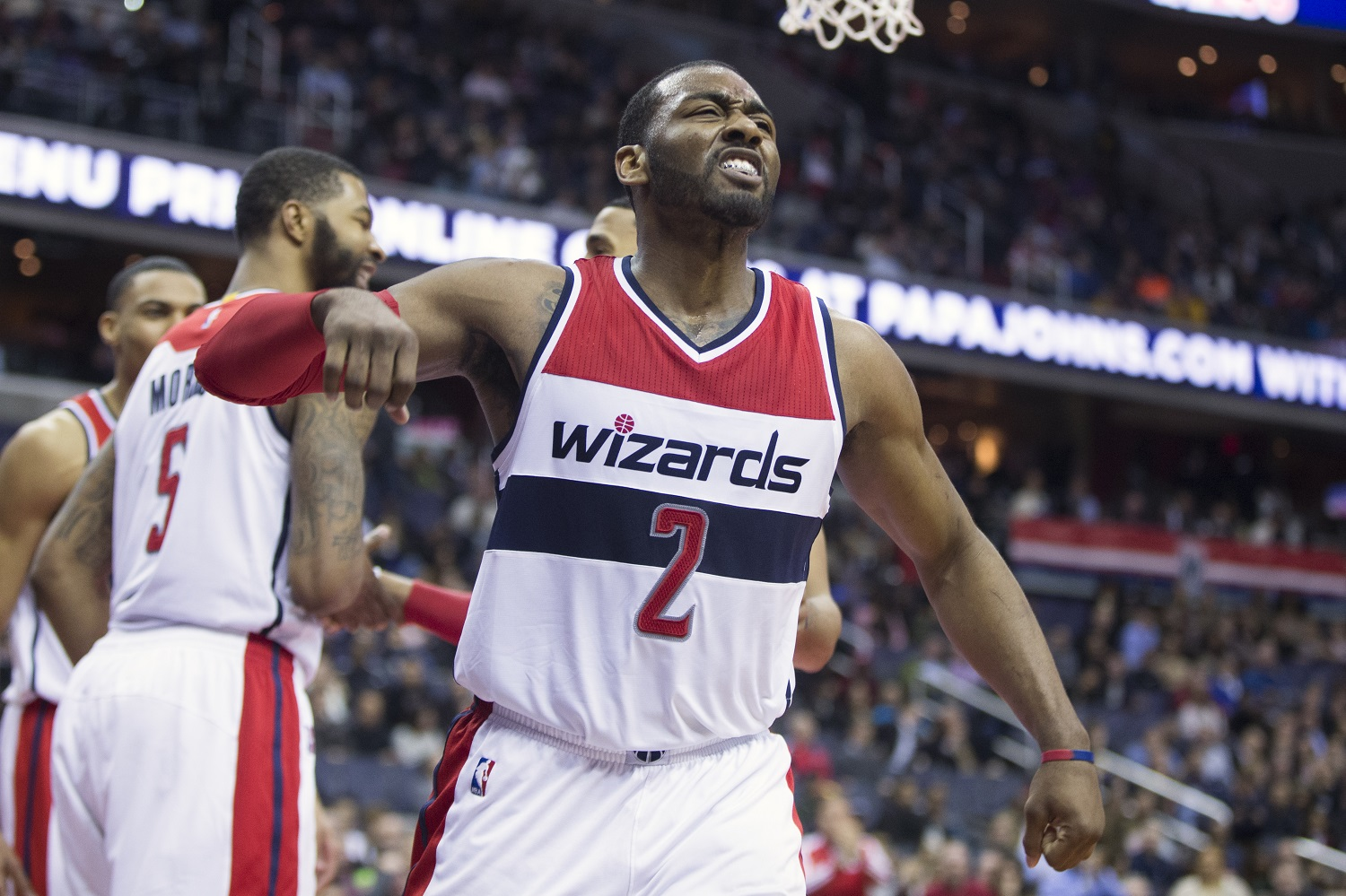Washington Wizards guard John Wall celebrates a basket against the Philadelphia 76ers during the second half of an NBA basketball game, on Monday, Feb. 29, 2016, in Washington. The Wizards defeated the 76ers 116-108. (AP Photo/Evan Vucci)