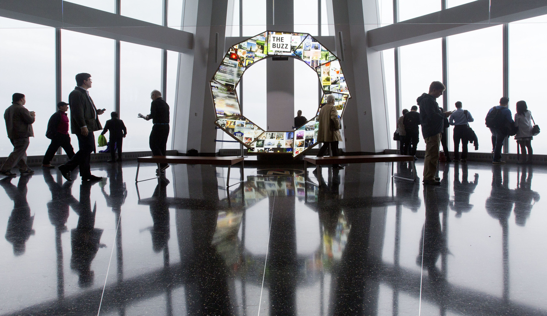 Visitors to One World Observatory take in views of New York and New Jersey, Tuesday, May 24, 2016, in New York. It's been a year since the observatory at One World Trade Center opened to the public. (AP Photo/Mark Lennihan)