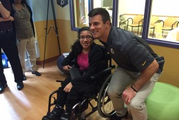 Redskins linebacker Ryan Kerrigan poses with a patient at HSC Pediatric Hospital after donating $15,000 in toys and therapy tools to the kids. (WTOP/Megan Cloherty)