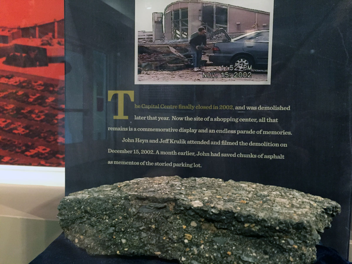 The exhibition includes an actual piece of the Capital Centre parking lot.  A shopping center, The Boulevard at the Capital Centre, is located at the site today. (WTOP/Michelle Basch)