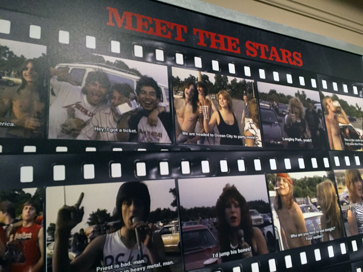 One part of the exhibition features the film's many memorable people. Jeff Krulik calls them the Heavy Metal Parking Lot Alumni. (WTOP/Michelle Basch)
