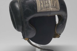Boxing gear worn by Muhammad Ali circa 1973. The headgear is an item in the collection of the Smithsonian National Museum of African American History and Culture. (Courtesy Collection of the Smithsonian National Museum of African American History and Culture)