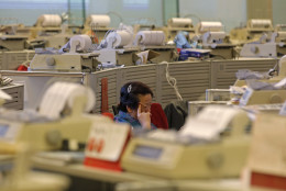 A floor trader studies stock prices at the Hong Kong Stock Exchange, Friday, June 24, 2016. Global financial markets dived on Friday as British media forecast Britain to leave the European Union. (AP Photo/Kin Cheung)