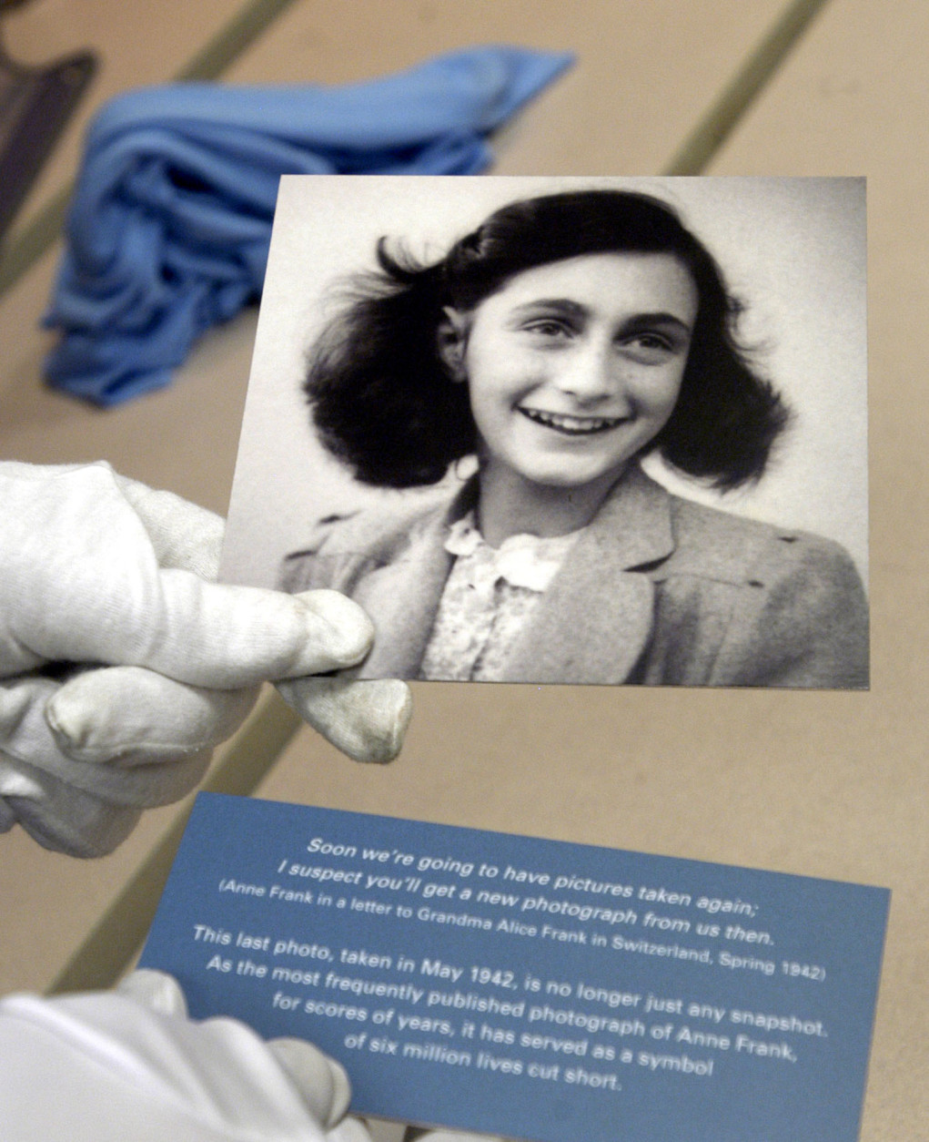 The most frequently published photograph of Anne Frank is prepared for display Tuesday, Aug. 3, 2004, at the Holocaust Museum Houston. The photo is one of dozens from the Frank family album to be on exhibit at the museum from Thursday through Dec. 31. Anne Franks' diary was published after the end of World War II making her arguably the most famous of the nearly 6 million victims of Hitler's attempt to exterminate the Jews. (AP Photo/Pat Sullivan)