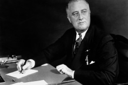 U.S. President Franklin D. Roosevelt is seen on the eve of his inauguration for a second term on Jan. 19, 1937, at his desk in the White House in Washington.  (AP Photo)