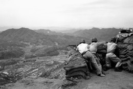 Three South Korean riflemen man a position in the hills as they watch movement of Communist troops in the area beneath them. North Korean Communist troops on June 25, 1950 officially estimated at 50,000, invaded the American-sponsored South Korean republic. Early reports said the surprise onslaught by the Russian-trained North Koreans was supported by tanks and heavy artillery. (AP Photo)