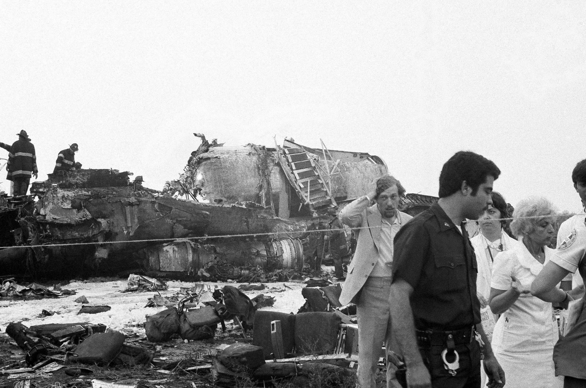 Firemen work amidst the wreckage of an Eastern Airlines 727 jet that crashed at Kennedy Airport in the Queens borough of New York, June 24, 1974, with a reported death toll of more than 100.  The plane was en route from New Orleans. (AP Photo)