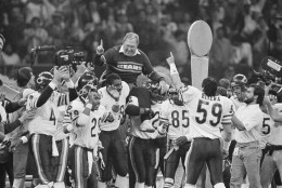 Chicago Bears defensive coordinator Buddy Ryan is carried off the field by the team after the Bears beat the New England Patriots 46-10, on Jan. 26, 1986 in New Orleans, to win Super Bowl XX. (AP Photo)