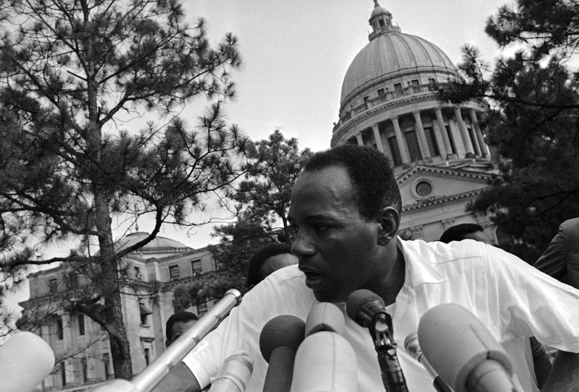 James Meredith, first speaker at a giant rally held on the grounds of the Mississippi State Capitol at Jackson, June 26, 1966, tells of the purpose of the march he initiated on June 5 at Memphis, Tenn.  The side and back of Meredith's head was shaven to remove buckshot after he was shot from ambush on June 6 near Hernando on the second day of his march. (AP Photo)