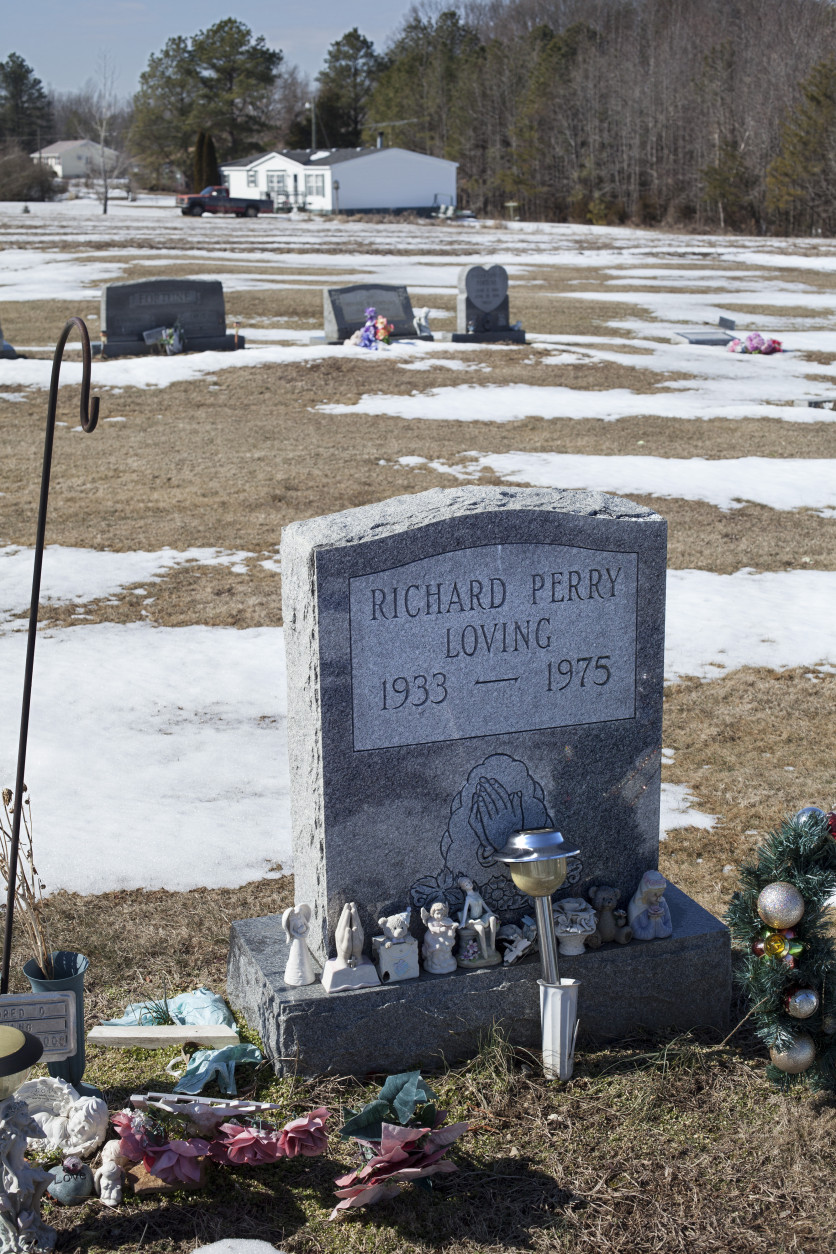 The graves of Richard and Mildred Loving are seen in a rural cemetery near their home in Caroline County, Virginia, Sunday, Feb. 16, 2014. Richard Loving, a white man, and his wife Mildred, a black woman, were banished from their home state of Virginia in 1958 where interracial marriage was prohibited under state law. The Supreme Court, in Loving v. Virginia, declared that law to be unconstitutional. This week, U.S. District Judge Arenda Wright Allen invoked the Loving case several times in her ruling against Virginia's same-sex marriage ban in Bostic v. Rainey.  (AP Photo/J. Scott Applewhite)