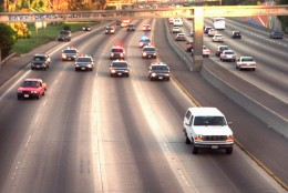 A white Ford Bronco, driven by Al Cowlings and carrying O.J. Simpson, is trailed by police cars as it travels on a southern California freeway on June 17, 1994, in Los Angeles.  Cowlings and Simpson led authorities on a chase after Simpson was charged with two counts of murder in the deaths of his ex-wife and her friend.  (AP Photo/Joseph Villarin)