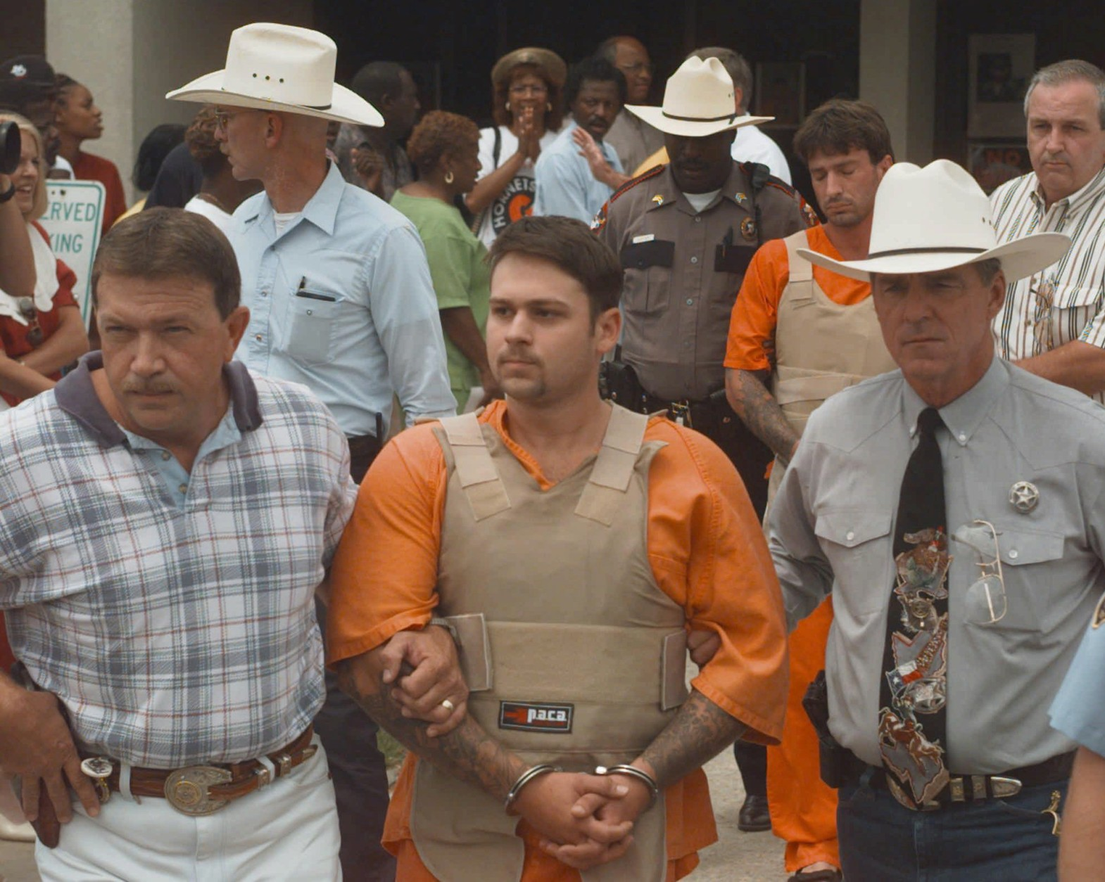 John William King, front, and Lawrence Russell Brewer are escorted from the Jasper County Jail Tuesday, June 9, 1998, in Jasper, Texas. King, Brewer and Shawn Allen Berry are charged with first degree murder in the death of James Byrd Jr.  Byrd Jr. was tied to a truck and dragged to his death along a rural East Texas road. (AP Photo/David J. Phillip)