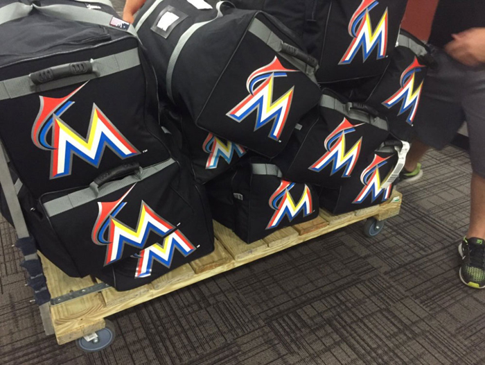 Player bags, with the parent club Miami Marlins logo, are one of a team's biggest hidden expenses. (Tim Grubbs)