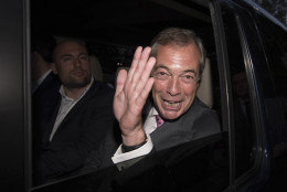 """Nigel Farage, the leader of the UK Independence Party, celebrates  as he leaves a """"Leave.EU"""" organization party for the British European Union membership referendum in London, Friday, June 24, 2016. On Thursday, Britain voted in a national referendum on whether to stay inside the EU.  (Stefan Rousseau/PA via AP) UNITED KINGDOM OUT, NO SALES, NO ARCHIVE"""