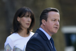 Britain's Prime Minister David Cameron speaks outside 10 Downing Street, London as his wife Samantha looks on Friday, June 24, 2016. Cameron says he will resign by the time of party conference in the fall after  Britain voted to leave the European Union after a bitterly divisive referendum campaign, according to tallies of official results Friday. (Lauren Hurley/PA via AP) UNITED KINGDOM OUT, NO SALES, NO ARCHIVE