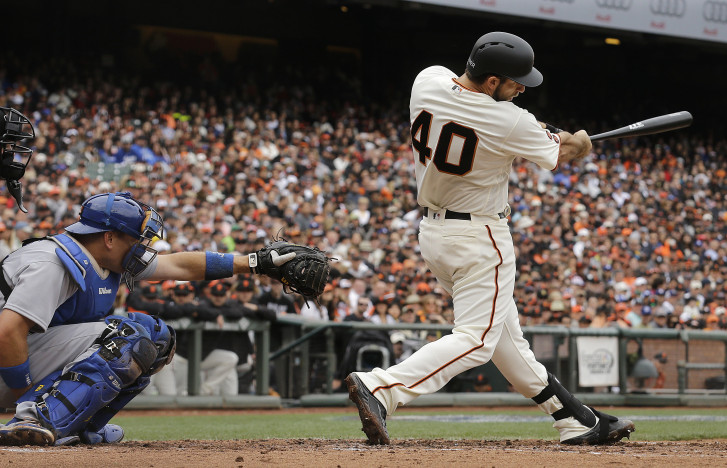 Giants will let Bumgarner hit for himself in AL park