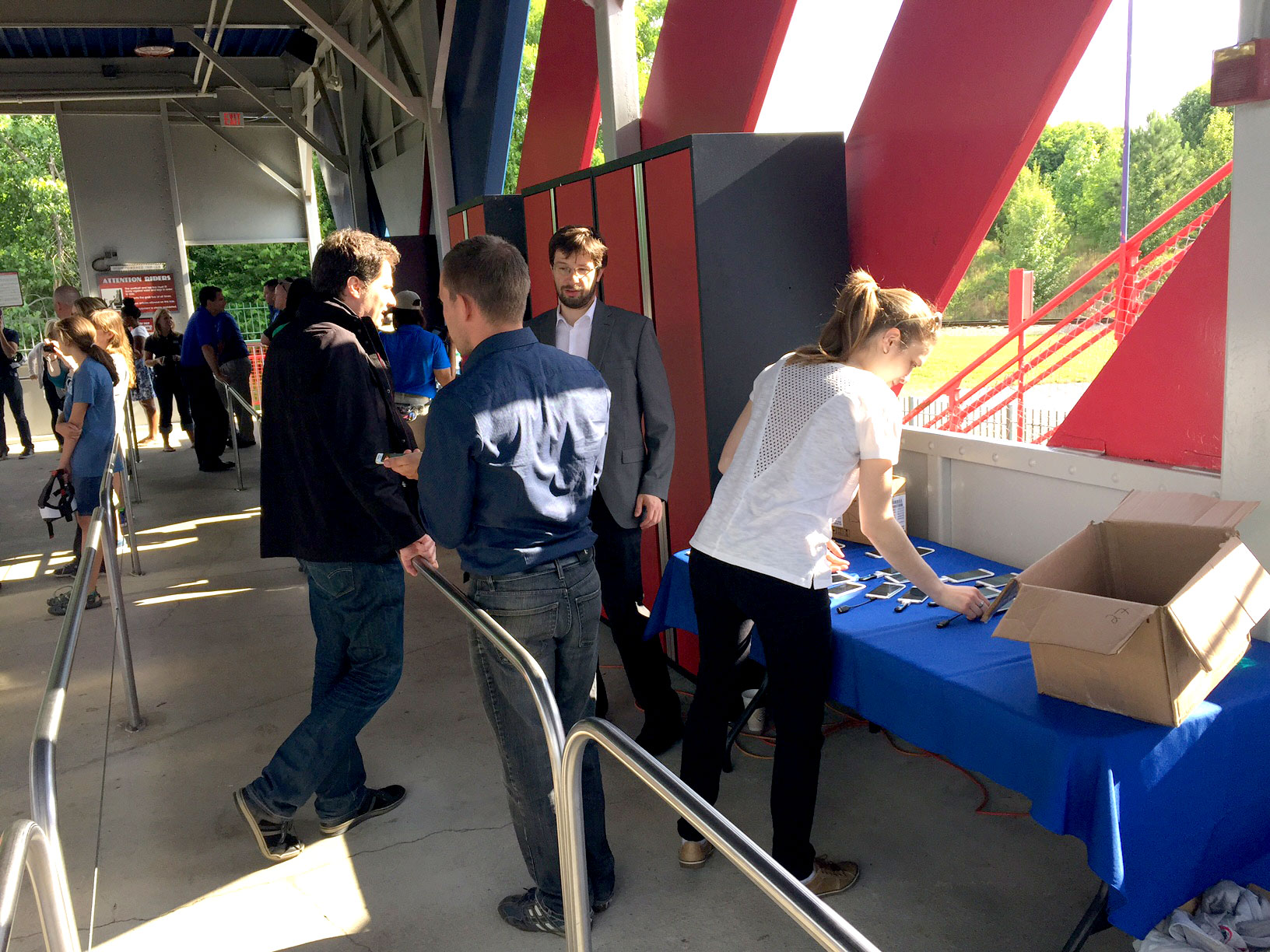 The German team behind SUPERMAN: Ride of Steel Virtual Reality Coaster at Six Flags America checks the gear that makes it work. (Courtesy Six Flags America)