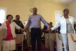 Residents worshiping in the historic Pleasant View Methodist Episcopal Church. (WTOP/Kate Ryan)