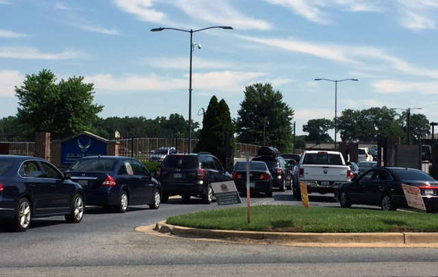 Cars line up outside the closed gate to Joint Base Andrews in Prince George's County on Thursday, June 30, 2016. The base was placed on lockdown after an active shooter was reported just before an active shooter drill was about to start. Defense Sec. Ash Carter said the drill was mistaken for a real threat. (WTOP/Darci Marchese)