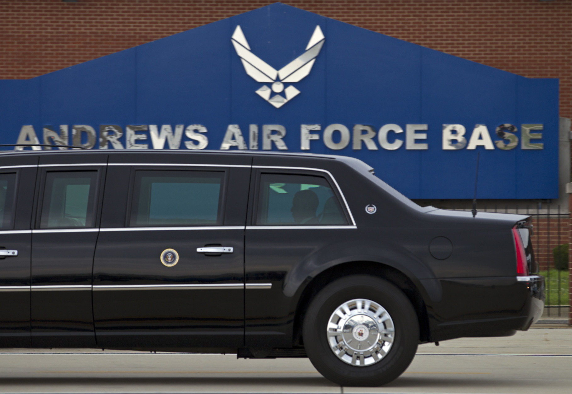 In this photo taken July 15, 2016, President Barack Obama rides in his limousine as he arrives at Joint Base Andrews, Md.  Joint Base Andrews tweets that the base is on lockdown due to a report of an active shooter. The tweet sent Thursday, June 30, 2016, instructs all personnel at the base in Washington's Maryland suburbs to shelter in place and says more information will be released as it comes. (AP Photo/Jose Luis Magana)