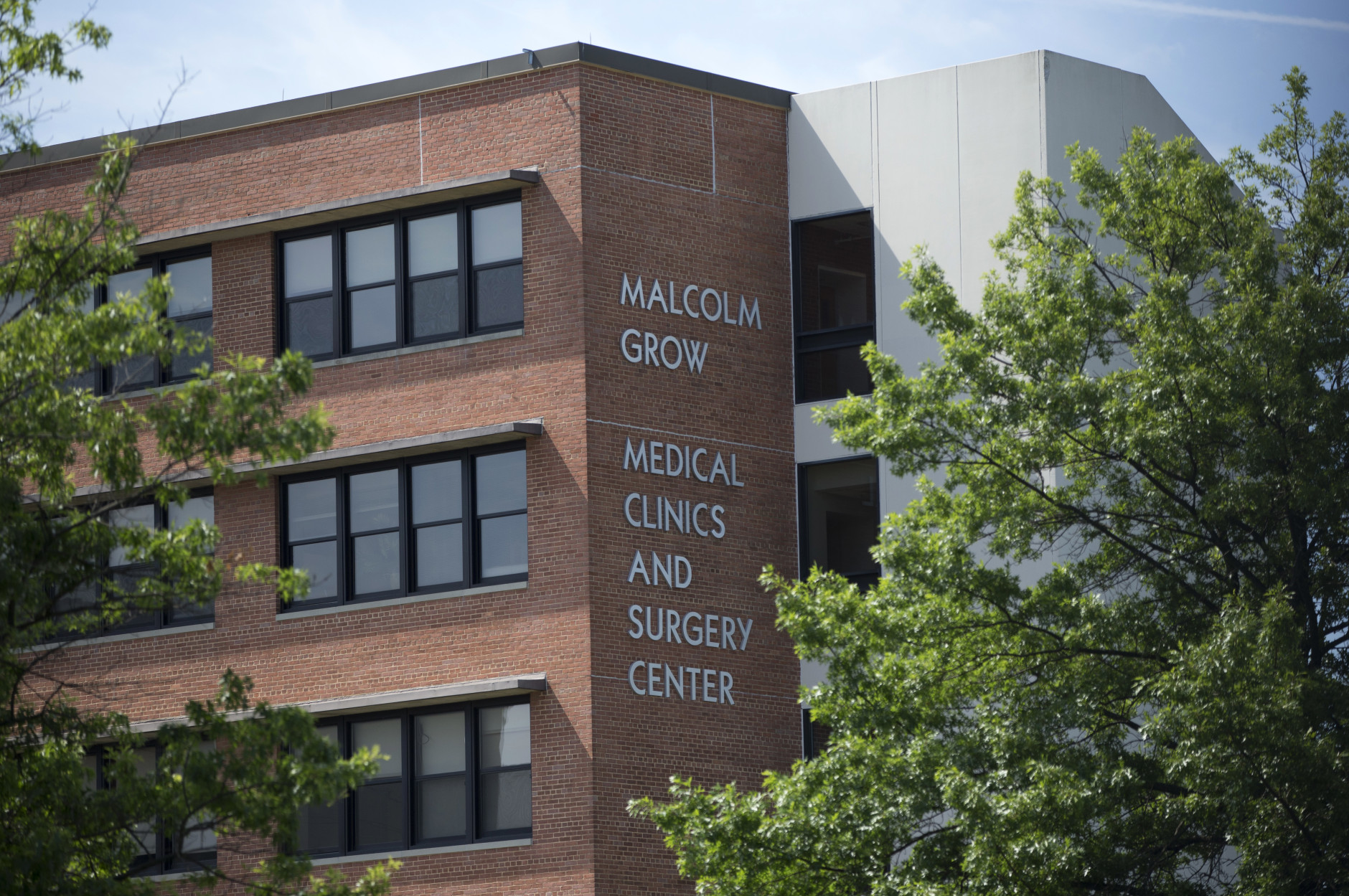 The Malcolm Grow Medical Center is seen at Joint Base Andrew, Md., Thursday, June 30, 2016. The military post near Washington said a lockdown was lifted Thursday except for a medical building where an active shooter was reported earlier in the day. Joint Base Andrews said in a tweet that the all-clear was given for the base except for the medical building. The base did not say why the Malcolm Grow Medical Facility remained on lockdown. (AP Photo/Carolyn Kaster)