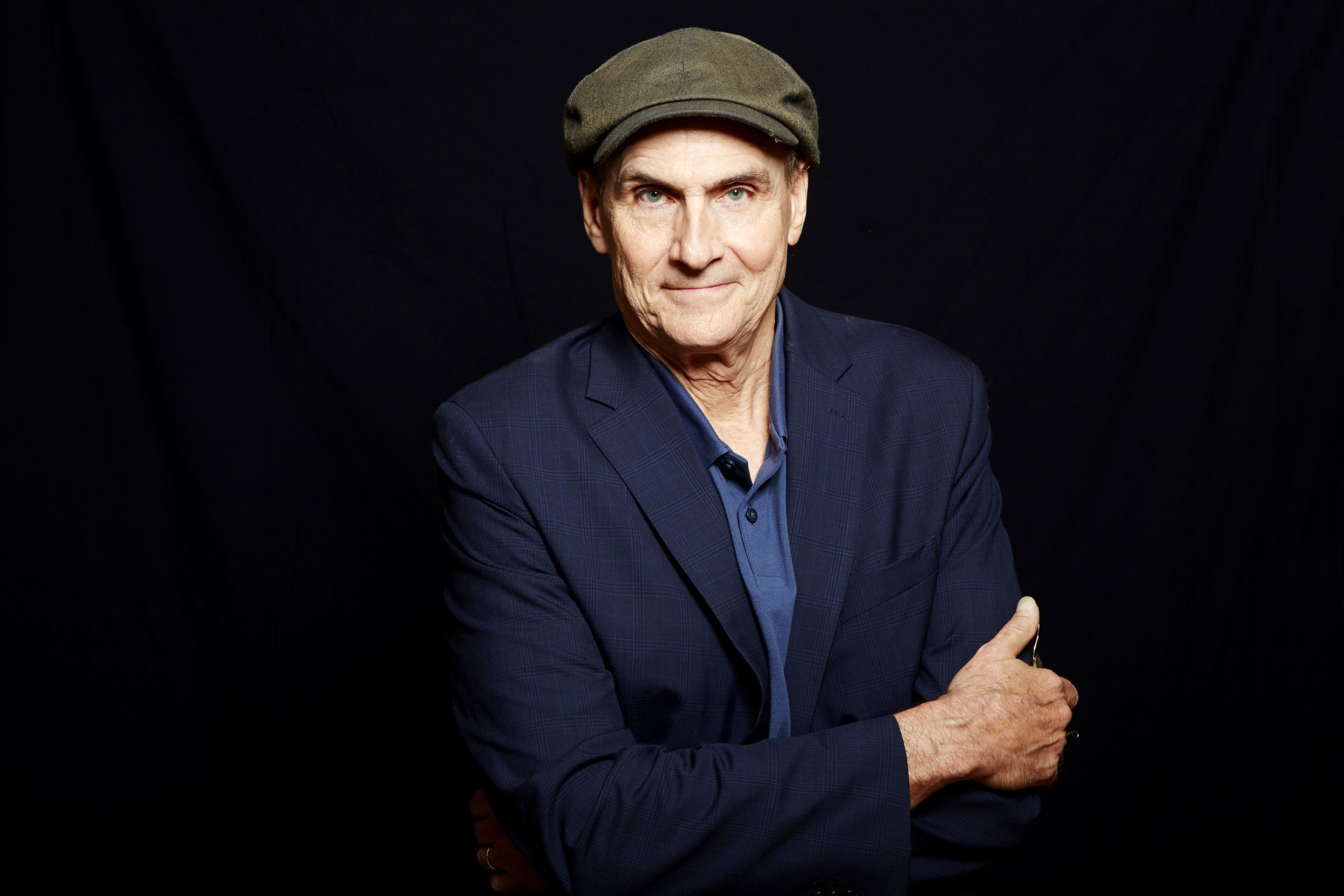 FILE - In this May 13, 2015 file photo, singer-songwriter James Taylor poses for a portrait in New York. This year's Kennedy Center honorees include musicians who span genres including pop, rock, gospel, blues, folk and classical _ and an actor known for his extraordinary range. The John F. Kennedy Center for the Performing Arts announced Thursday, June 23, 2016, that actor Al Pacino, rock band the Eagles, Argentine pianist Martha Argerich, gospel and blues singer Mavis Staples and singer-songwriter James Taylor will be honored for influencing American culture through the arts. (Photo by Dan Hallman/Invision/AP, File)