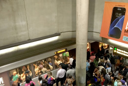 Residual crowding persists at the Gallery Place Metrorail station, where track debris triggered delays and forced inbound and outbound trains to share a single track on Thursday, June 23, 2016. (WTOP/Tiffany Arnold)