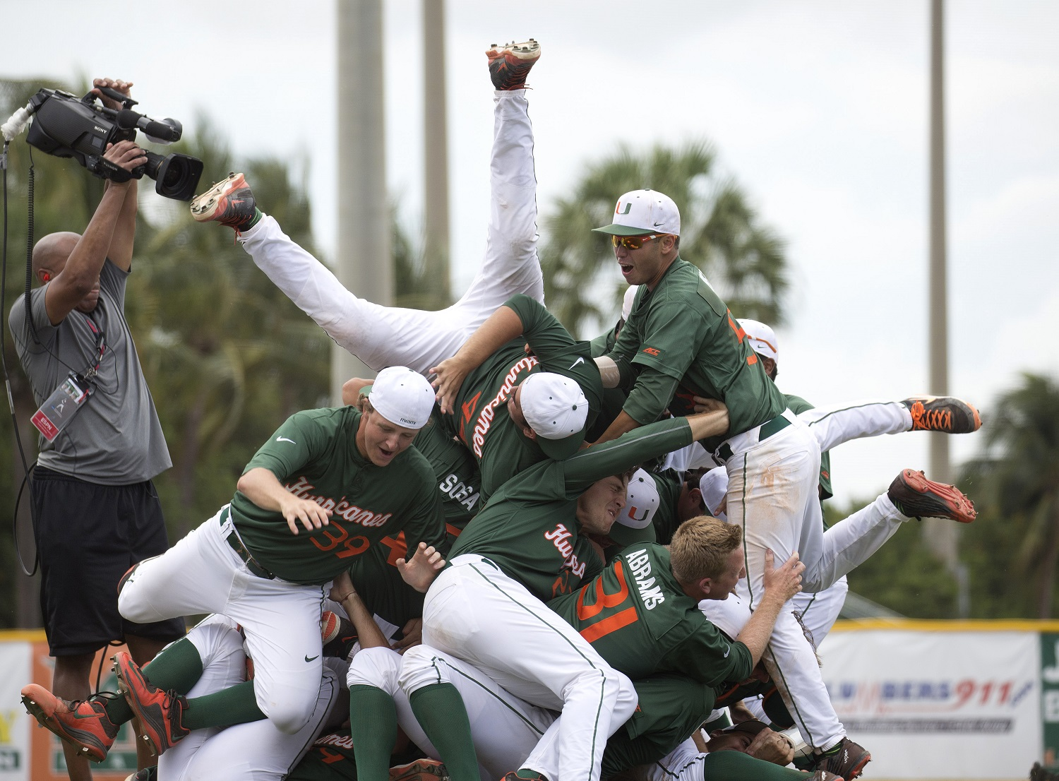 Miami Hurricane players celebrate after a super regional game of the NCAA college baseball tournament against VCU, Saturday, June 6, 2015, in Coral Gables, Fla.Miami won 10-3. (AP Photo/J Pat Carter)