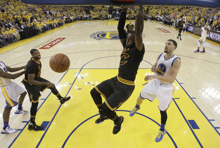 2bb7d2a6f5e Cleveland Cavaliers forward LeBron James dunks against Golden State  Warriors guard Klay Thompson (11) during the first half of Game 7 of  basketball s NBA ...