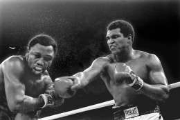 FILE - In this Oct. 1, 1975, file photo, spray flies from the head of challenger Joe Frazier as heavyweight champion Muhammad Ali connects with a right in the ninth round of their title fight in Manila, Philippines. Ali, the magnificent heavyweight champion whose fast fists and irrepressible personality transcended sports and captivated the world, has died according to a statement released by his family Friday, June 3, 2016. He was 74. (AP Photo/Mitsunori Chigita, File)