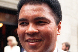 FILE - This is a 1995 file photo showing Muhammad Ali smiling during a visit to New York. Ali, the magnificent heavyweight champion whose fast fists and irrepressible personality transcended sports and captivated the world, has died according to a statement released by his family Friday, June 3, 2016. He was 74. (AP Photo/Mark Lennihan, FIle)