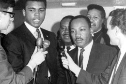 FILE - In this March 29, 1967, file photo, heavyweight champion Muhammad Ali, center left, and Dr. Martin Luther King speak to reporters. Ali, the magnificent heavyweight champion whose fast fists and irrepressible personality transcended sports and captivated the world, has died according to a statement released by his family Friday, June 3, 2016. He was 74. (AP Photo/File)