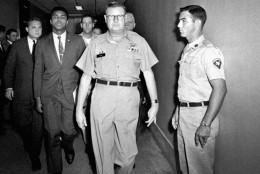 FILE - In this April 28, 1967 file photo, heavyweight boxing champion Muhammad Ali is escorted from the Armed Forces Examining and Entrance Station in Houston by Lt. Col. J. Edwin McKee, commandant of the station, after Ali refused Army induction. Ali, the magnificent heavyweight champion whose fast fists and irrepressible personality transcended sports and captivated the world, has died according to a statement released by his family Friday, June 3, 2016. He was 74. (AP Photo)