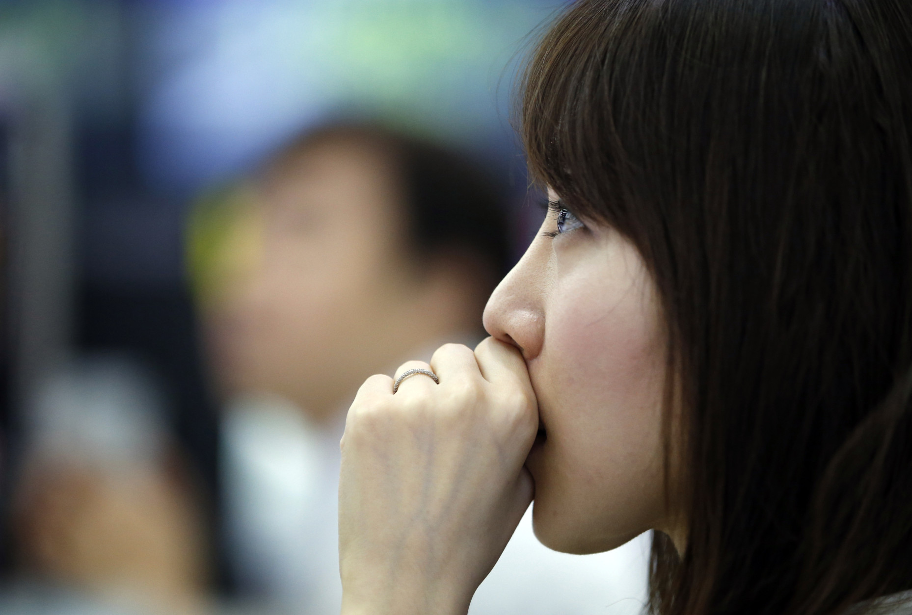 A dealer watches monitors at the foreign exchange dealing room in Seoul, South Korea, Friday, June 24, 2016. Asian stock markets were volatile on Friday with Tokyo stocks and U.S. futures plunging as early vote results on whether Britain should stay in the European Union showed a tight race. (AP Photo/Lee Jin-man)