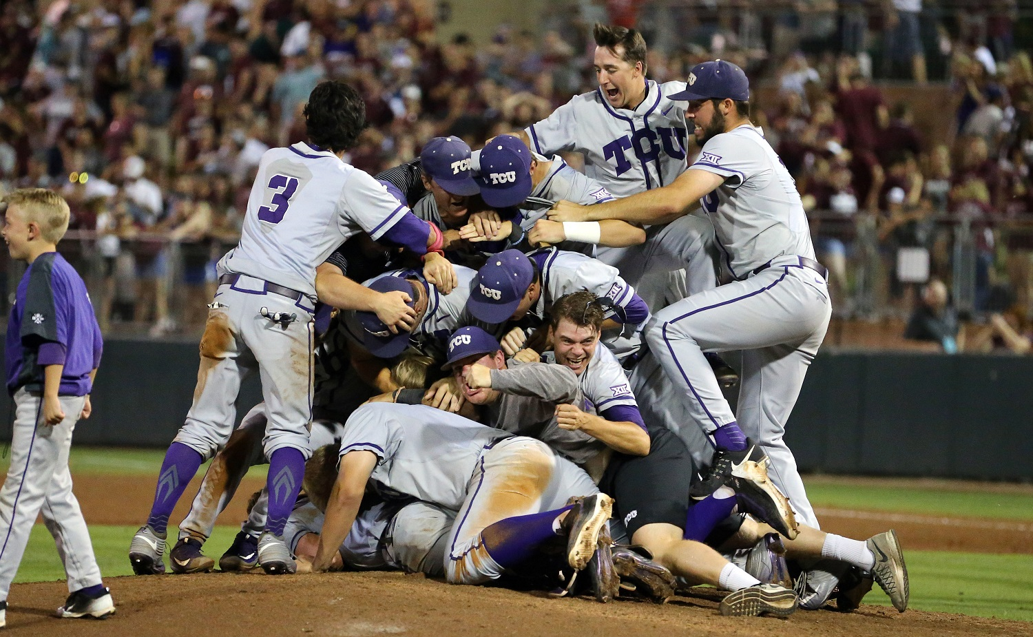 Members of the TCU baseball team dog pile on the pitchers mound after beating Texas A&M 4-1 in a NCAA college baseball Super Regional tournament game, Sunday, June 12, 2016, in College Station, Texas. (AP Photo/Sam Craft)