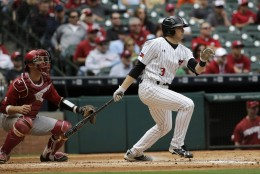 Texas Tech's Michael Davis (3) hits a two-run double as Arkansas catcher Tucker Pennell watches during the first inning of a College Classic baseball game Sunday, Feb. 28, 2016, in Houston. (AP Photo/David J. Phillip)