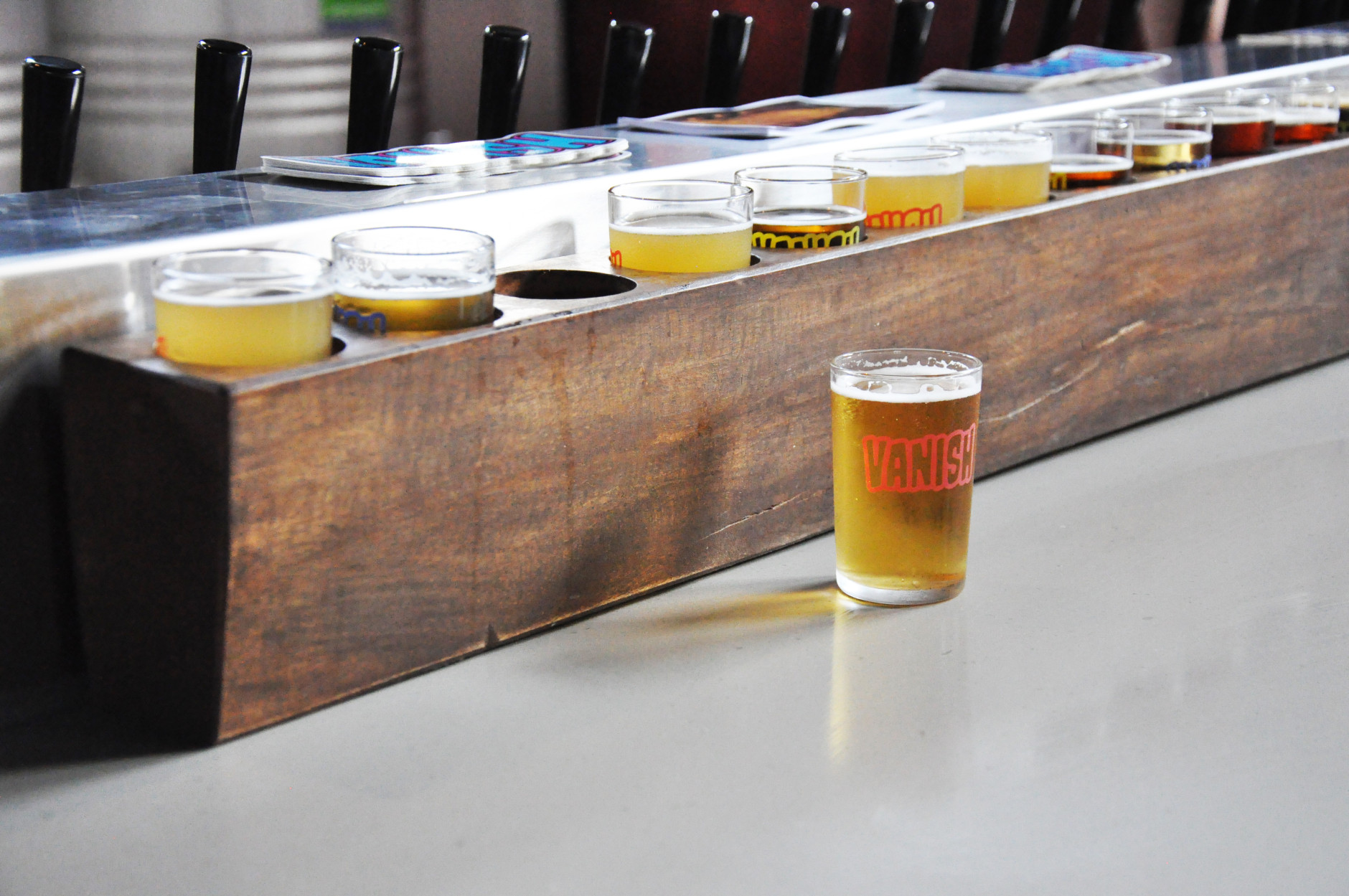 There are more than 16 beers on the menu at Vanish Brewery's tasting room. Owner Jonathan Staples says on the weekends, the Lucketts, Virginia brewery sees between 400 and 600 guests. (WTOP/Rachel Nania)