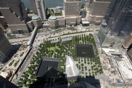 In this Wednesday, June 22, 2016 photo, the tree-lined September 11 Memorial can be seen from an upper floor of 3 World Trade Center in New York. The World Trade Center's latest new skyscraper has reached its full height of 80 stories. (AP Photo/Mark Lennihan)