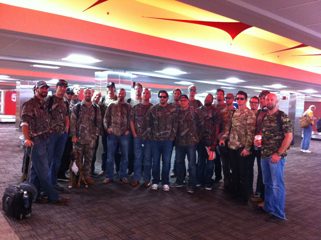 The 2013 Zephyrs team, wearing matching camouflage shirts as they wait at baggage claim. (Tim Grubbs)