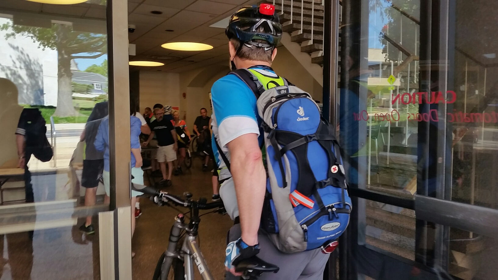 Attendees arrive for the Great Montgomery Bike Summit at Montgomery County Council headquarters in Rockville, Md. on Saturday, July 18, 2016. (WTOP/Kathy Stewart)