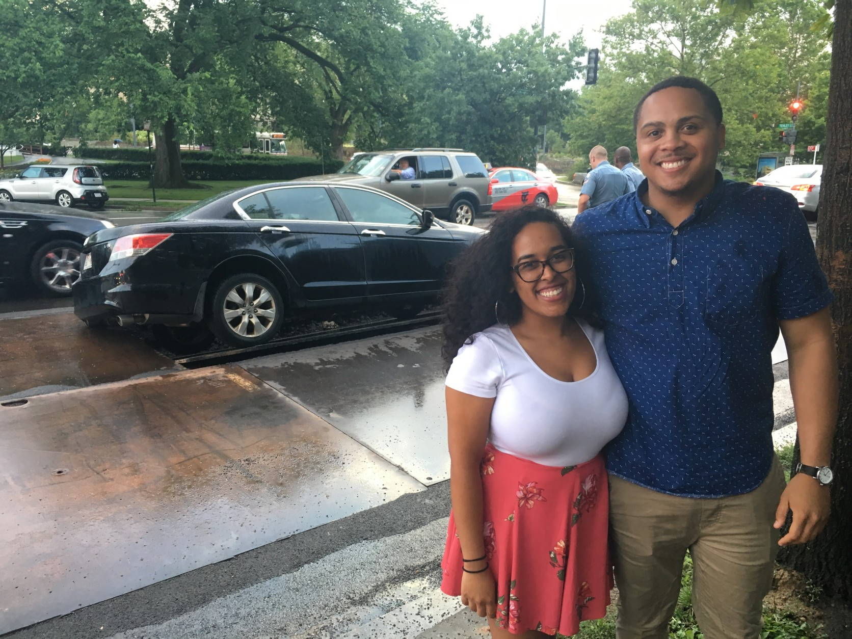 Scott Thomas and Britnni Guevarna were going to get milkshakes when the car they were in started to sink as it drove over a metal panel in Tenleytown. (Mike Murillo/WTOP)