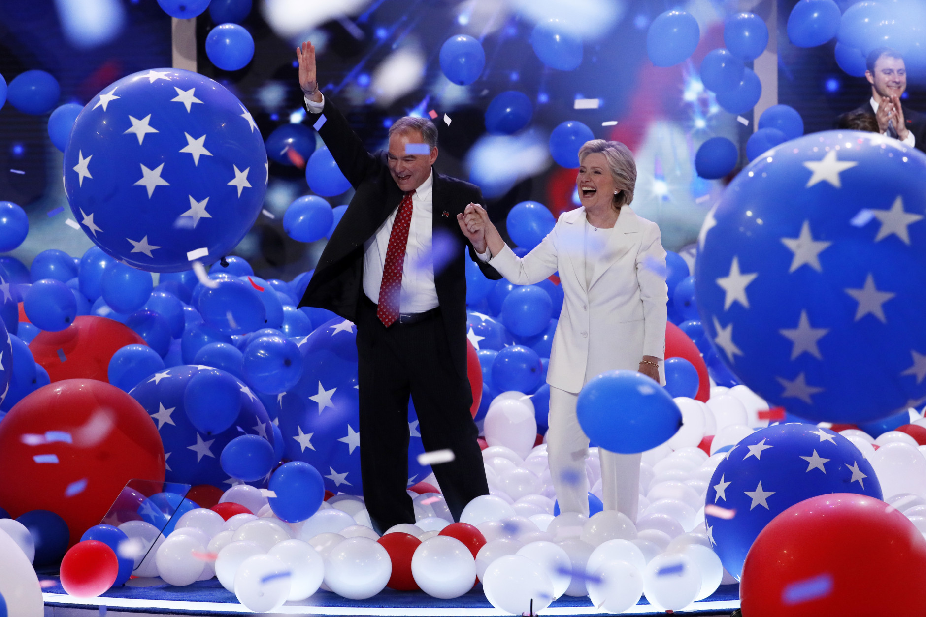 Democratic vice presidential nominee Sen. Tim Kaine, D-Va., and Democratic presidential nominee Hillary Clinton walk through the falling balloons during the final day of the Democratic National Convention in Philadelphia , Thursday, July 28, 2016. (AP Photo/J. Scott Applewhite)