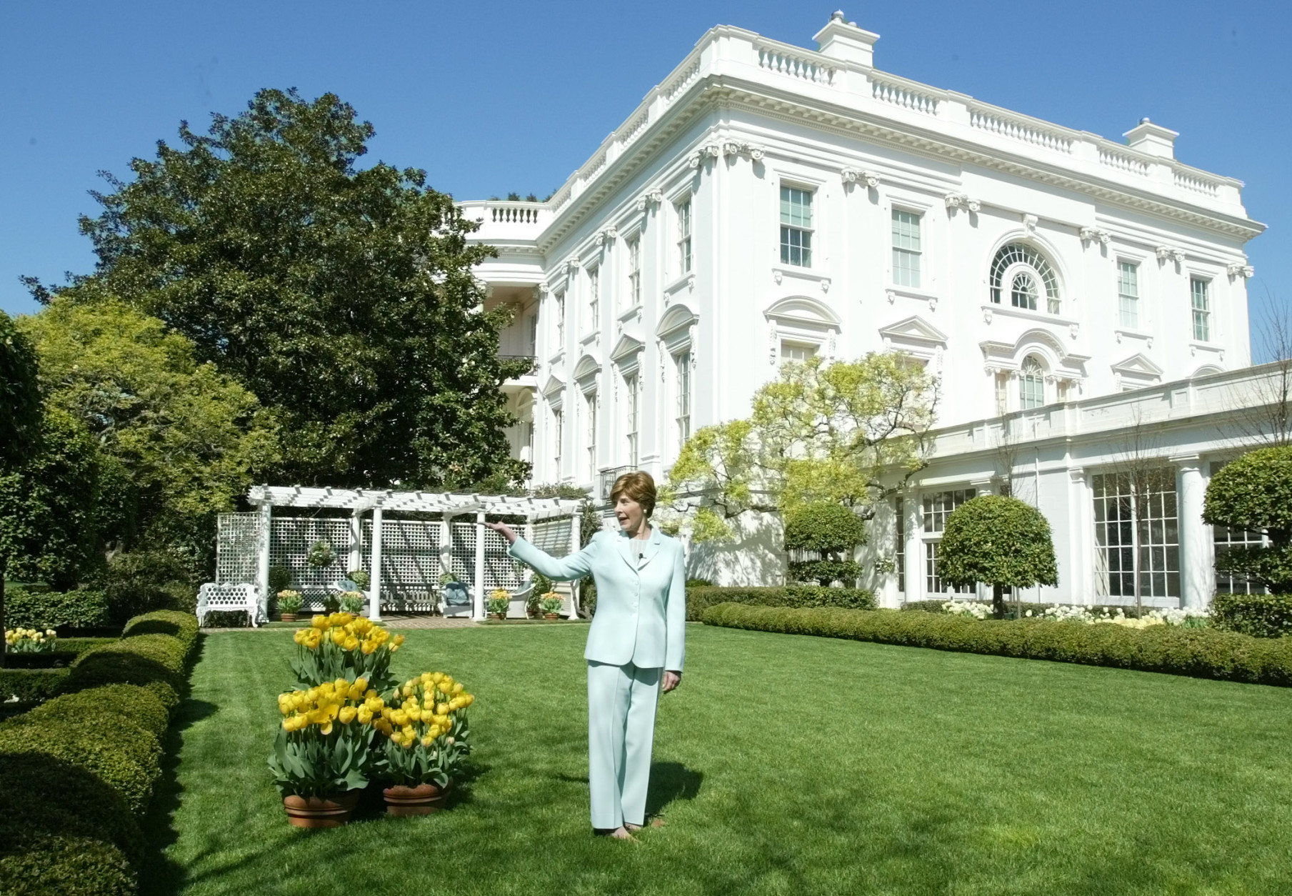 First lady Laura Bush gives a tour of the Jacqueline Kennedy Garden at the White House for members of the media Friday, April 16, 2004 in Washngton. (AP Photo/Manuel Balce Ceneta)