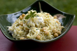**FOR USE WITH AP LIFESTYLES**   This Sunday, June 1, 2008 photo shows a bowl of Orzo with Chickpeas. This simple dish is a Mediterranean take on pasta salad, blending rice-like orzo pasta with chickpeas and goat cheese. It can be served warm or at room temperature.   (AP Photo/Larry Crowe)