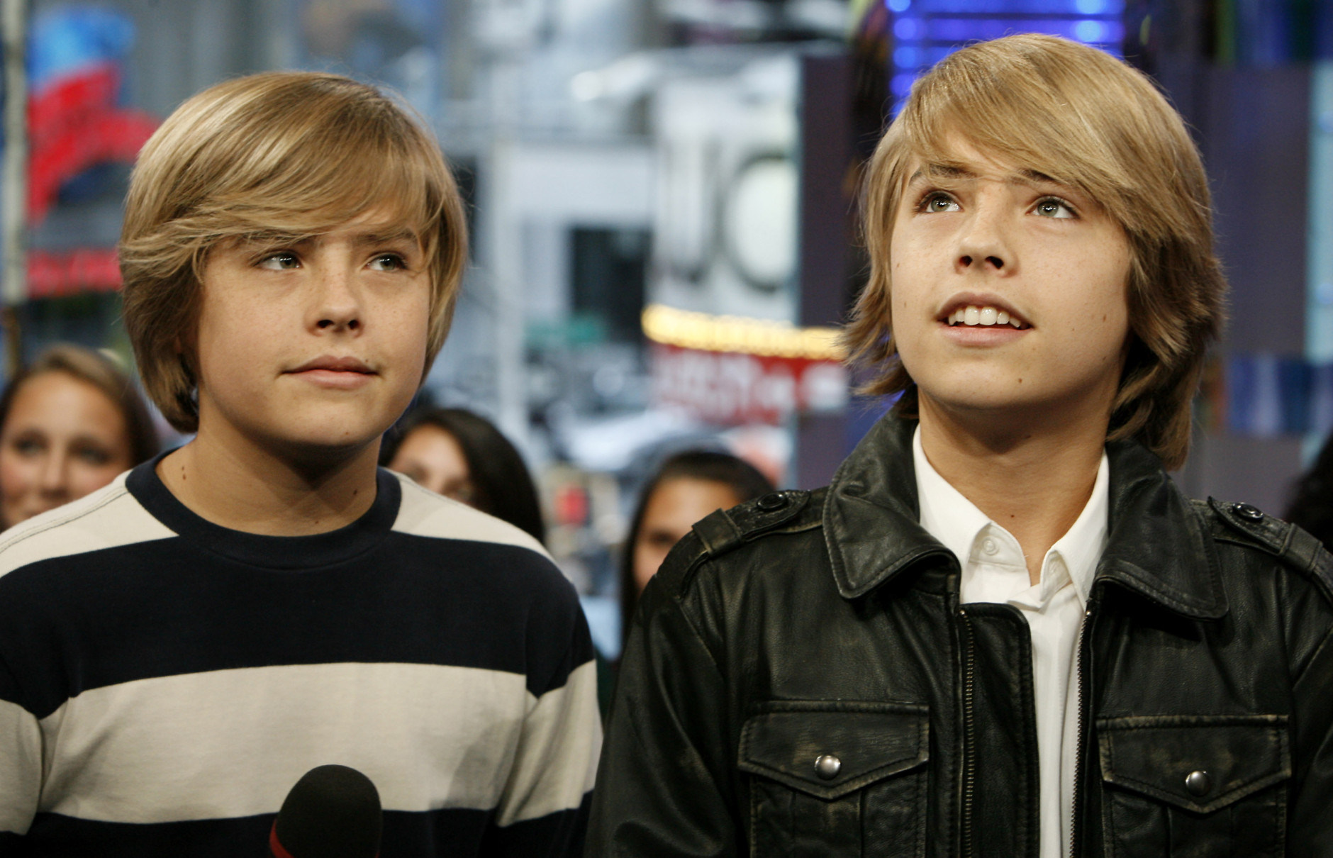 """Actors Dylan Sprouse, left, and Cole Sprouse appear onstage during MTV's """"Total Request Live"""" at the MTV Times Square Studios Tuesday, Oct. 14, 2008 in New York.  (AP Photo/Jason DeCrow)"""