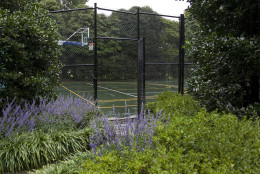 The tennis and basketball court is seen near the Children's Garden at the White House in Washington Thursday, Oct. 15, 2009. Tens of thousands of people are expected to stream through the White House gates this weekend for a rare opportunity to see the fragrant roses, blue salvias and towering, decades-old trees that beautify the president's back yard. (AP Photo/Alex Brandon)