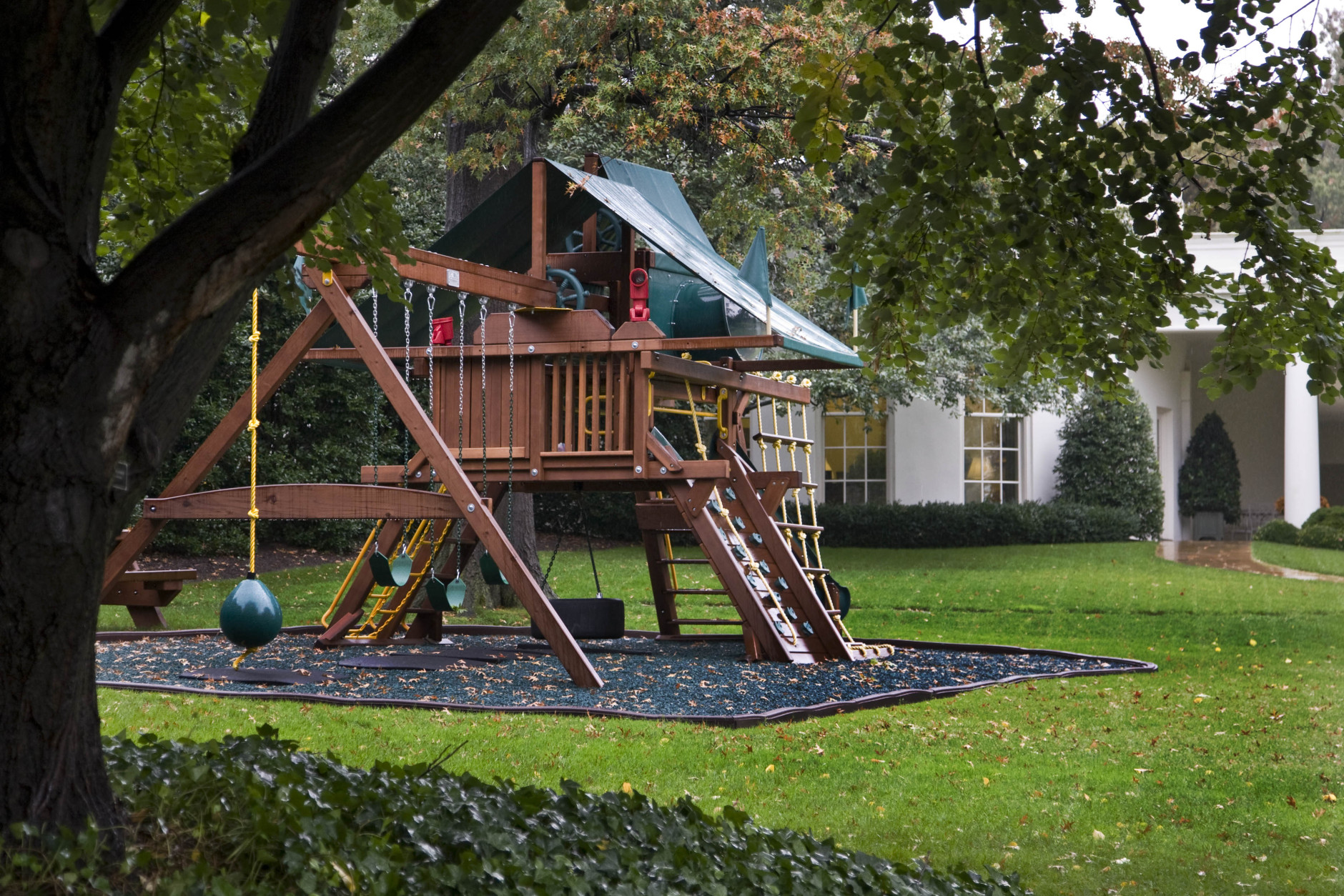 The swing set, installed for the children of President Barack Obama, Malia and Sasha, is seen with the Oval Office behind it at the White House in Washington Thursday, Oct. 15, 2009. The White House gardens will be open to the public for rare tours this weekend.  (AP Photo/Alex Brandon)