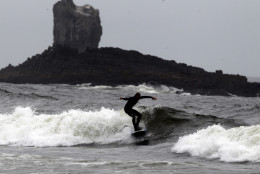 A surfer rides a wave along Indian Beach Friday, July 30, 2010, at Ecola State Park, near Cannon Beach, Ore. (AP Photo/Rick Bowmer)