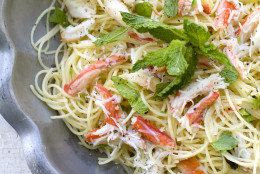 This May 2, 2011 photo shows angel hair pasta with crabmeat, jalapeno and mint in Concord, N.H. Chef Jonathan Waxman, of the New York restaurant Barbuto, says freshly cooked crab is essential for this recipe.   (AP Photo/Matthew Mead)