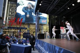 "Olympic fencers Kat Holmes, right, and Jason Pryor give a fencing demonstration in Times Square in New York, Wednesday, April 27, 2016. These athletes and many others were participating in an event called ""Team USA's Road to Rio"" to promote the upcoming Olympic Games. (AP Photo/Seth Wenig)"